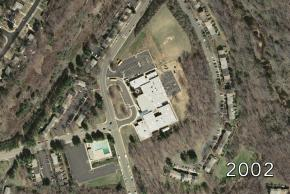 Aerial view of Kings Glen Elementary School in 2002. The school has two new sections added on and a covered entryway.