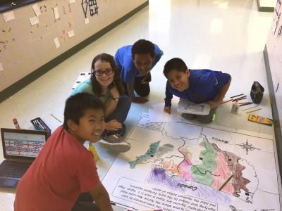 Photo of students creating giant floor map