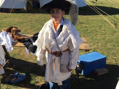 photo of student learning about colonial garb
