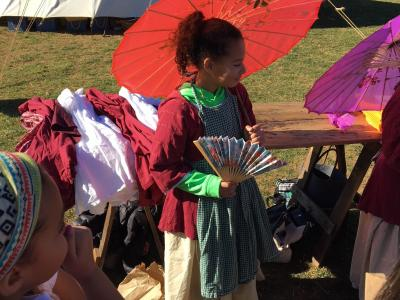 photo of students learning about colonial garb