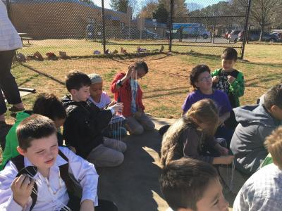 photo of students learning to make colonial cords