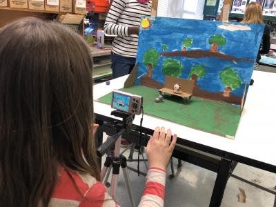 photo of students taking photos of a  mini painted set