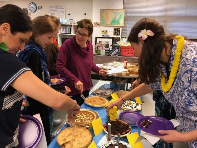 photos of teachers wearing beach garb and cutting pies to eat