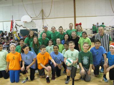 photo of sixth grade student volleyball team and teachers they opposed, posing as a team