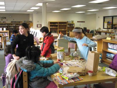 photo of students working and creating things at a table