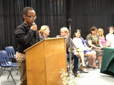 photo of student at podium on stage