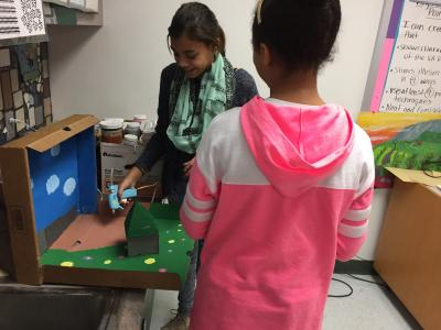 photo of two students working on mini claymation set