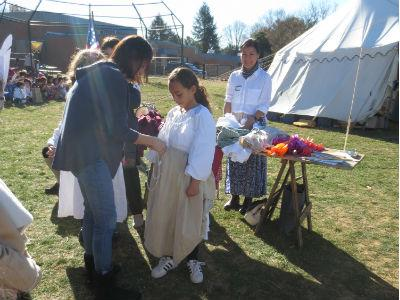 photo of students outside learning about colonial clothes