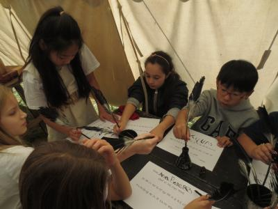 photo of students learning about colonial writing