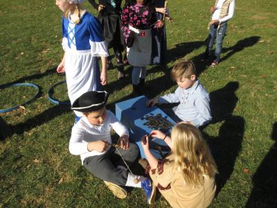 photo of students learning about colonial games