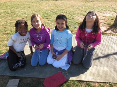 photo of students outside learning about colonial creating