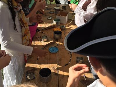 photo of students learning about colonial tools and creativity