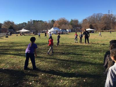 photo of students learning to play colonial rounders game