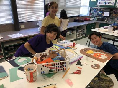 photo of students working with construction paper to create animal faces